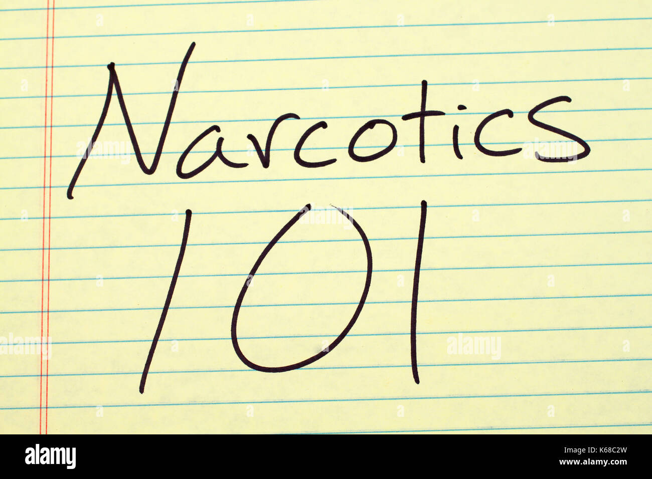 The words 'Narcotics 101' on a yellow legal pad - Stock Image
