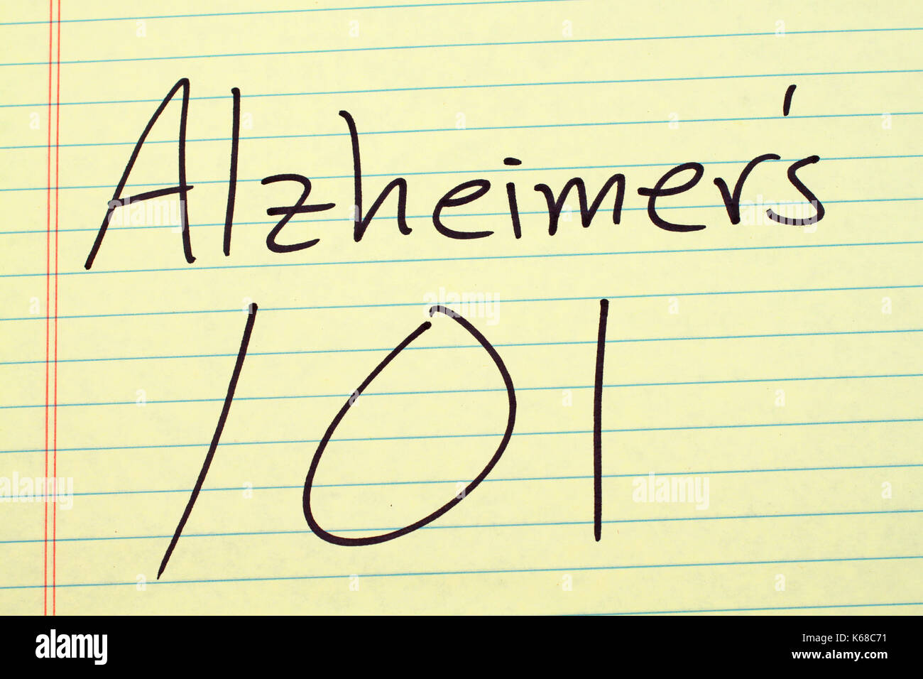 The words 'Alzheimer's 101' on a yellow legal pad - Stock Image