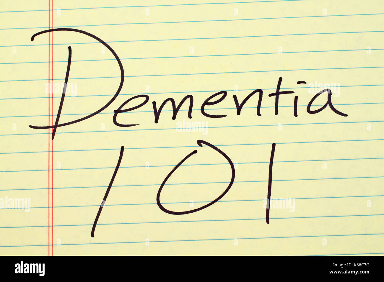 The words 'Dementia 101' on a yellow legal pad - Stock Image