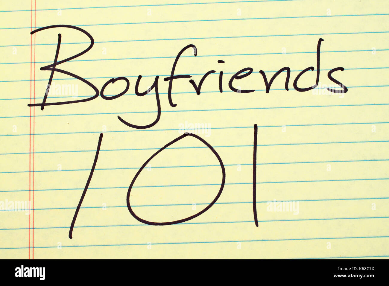 The words 'Boyfriends 101' on a yellow legal pad - Stock Image