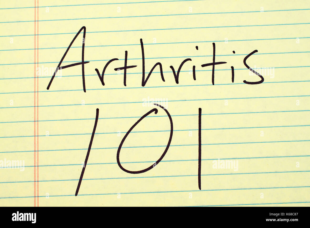 The words 'Arthritis 101' on a yellow legal pad - Stock Image