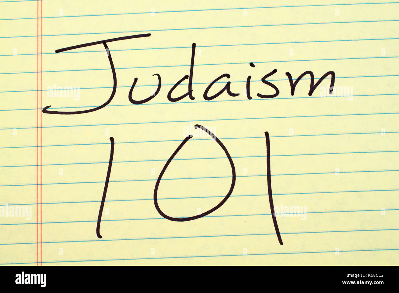"""The words """"Judaism 101"""" on a yellow legal pad Stock Photo"""