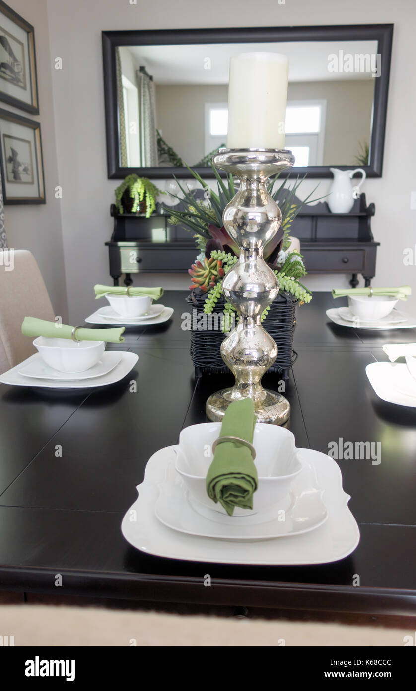 Looking Down A Brown Dining Room Table At Place Settings With Bowls Stock Photo Alamy