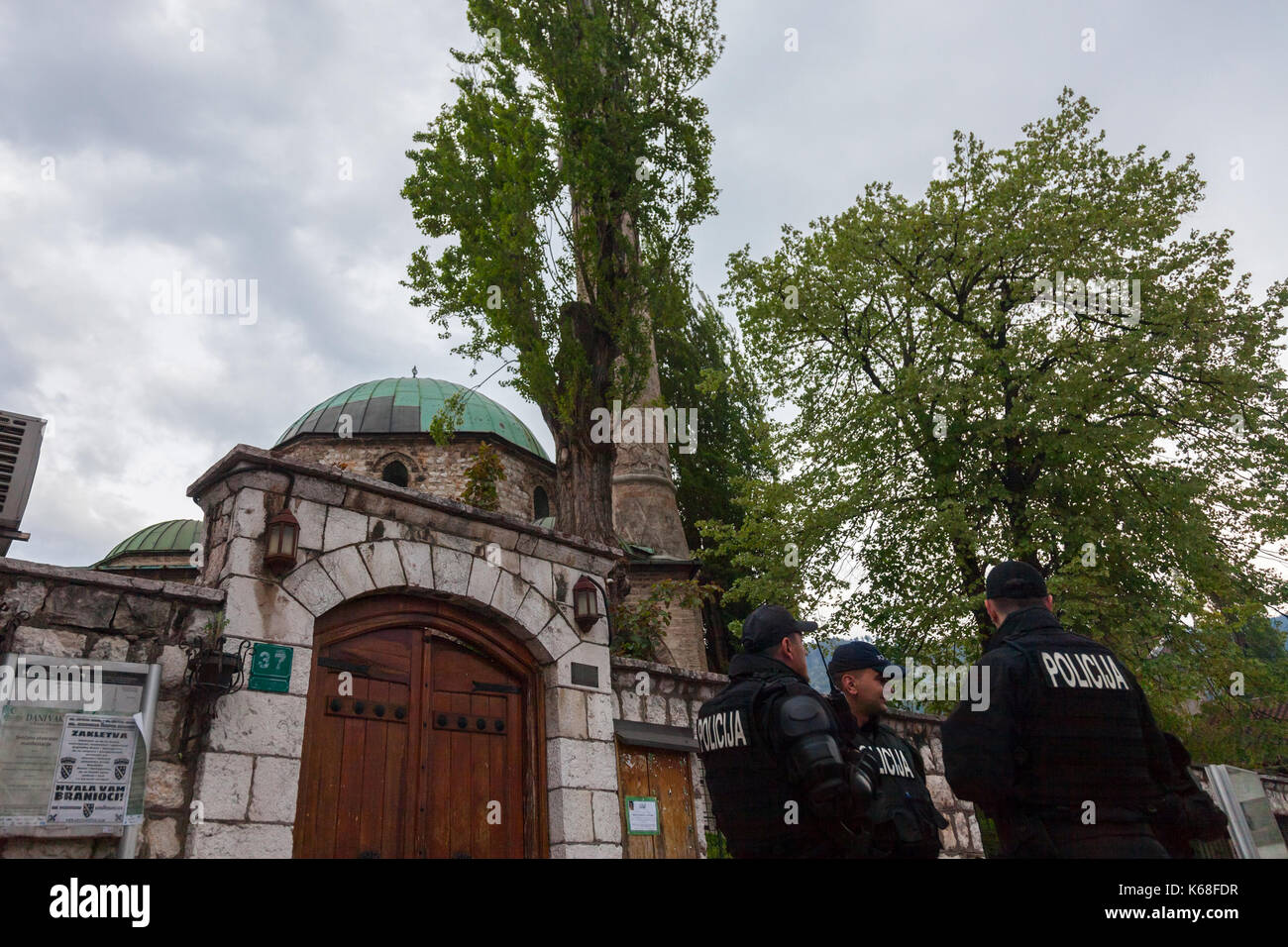 SARAJEVO, BOSNIA AND HERZEGOVINA - APRIL 15, 2017: Bosnian police units wearing bulletproof jackets patrolling in front of one of the mosques of the c - Stock Image