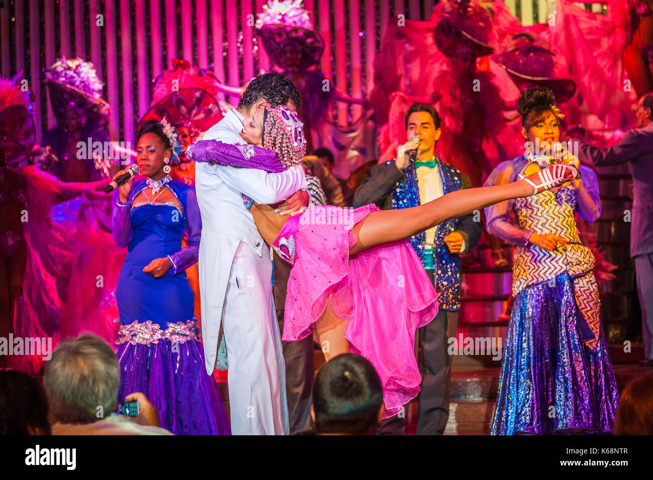 Exotic dancers performing live on stage in colourful costumes in a cabaret show for tourists in a nightclub in Havana, Cuba - Stock Image
