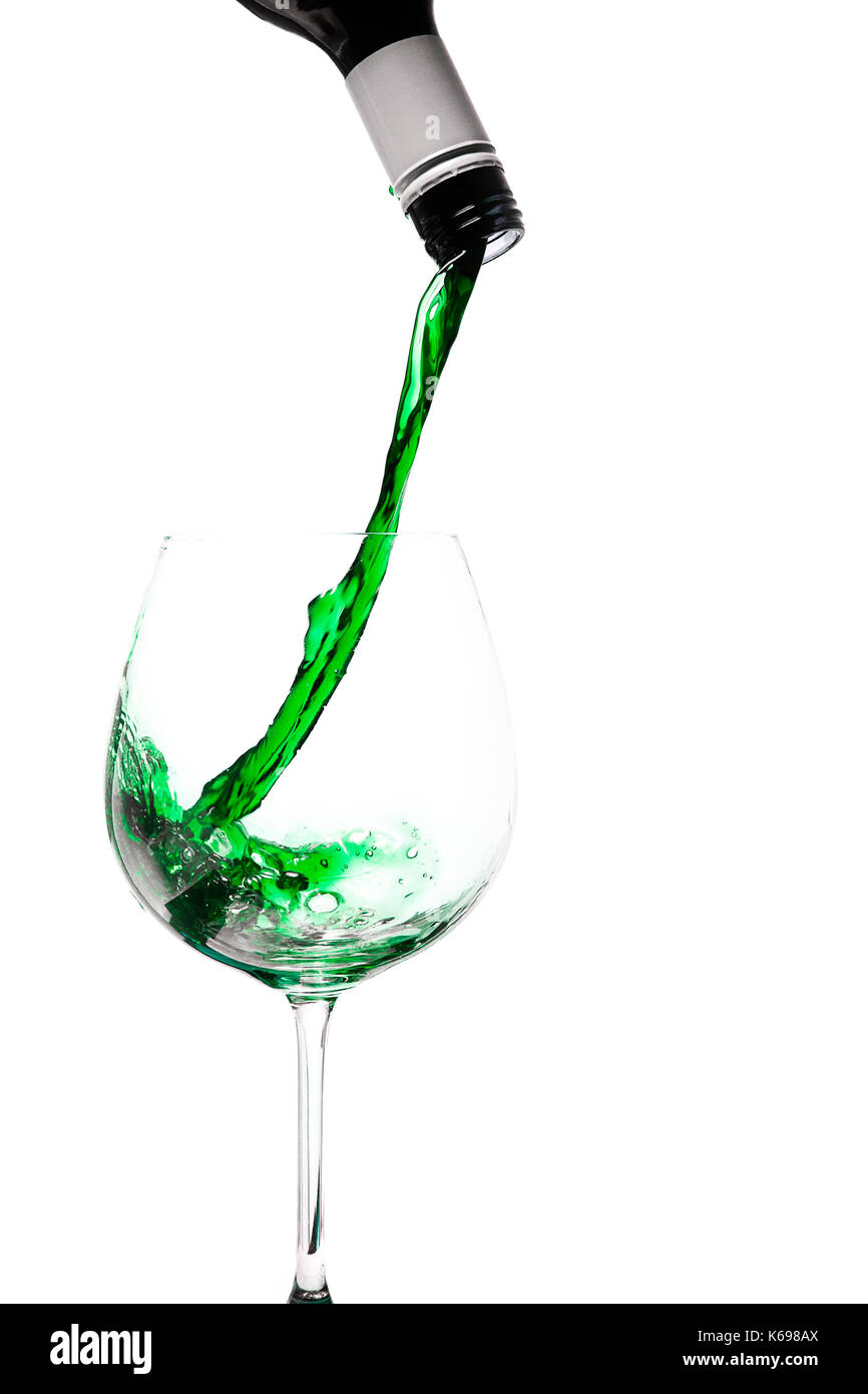 wine pouring into glass, green colour - Stock Image