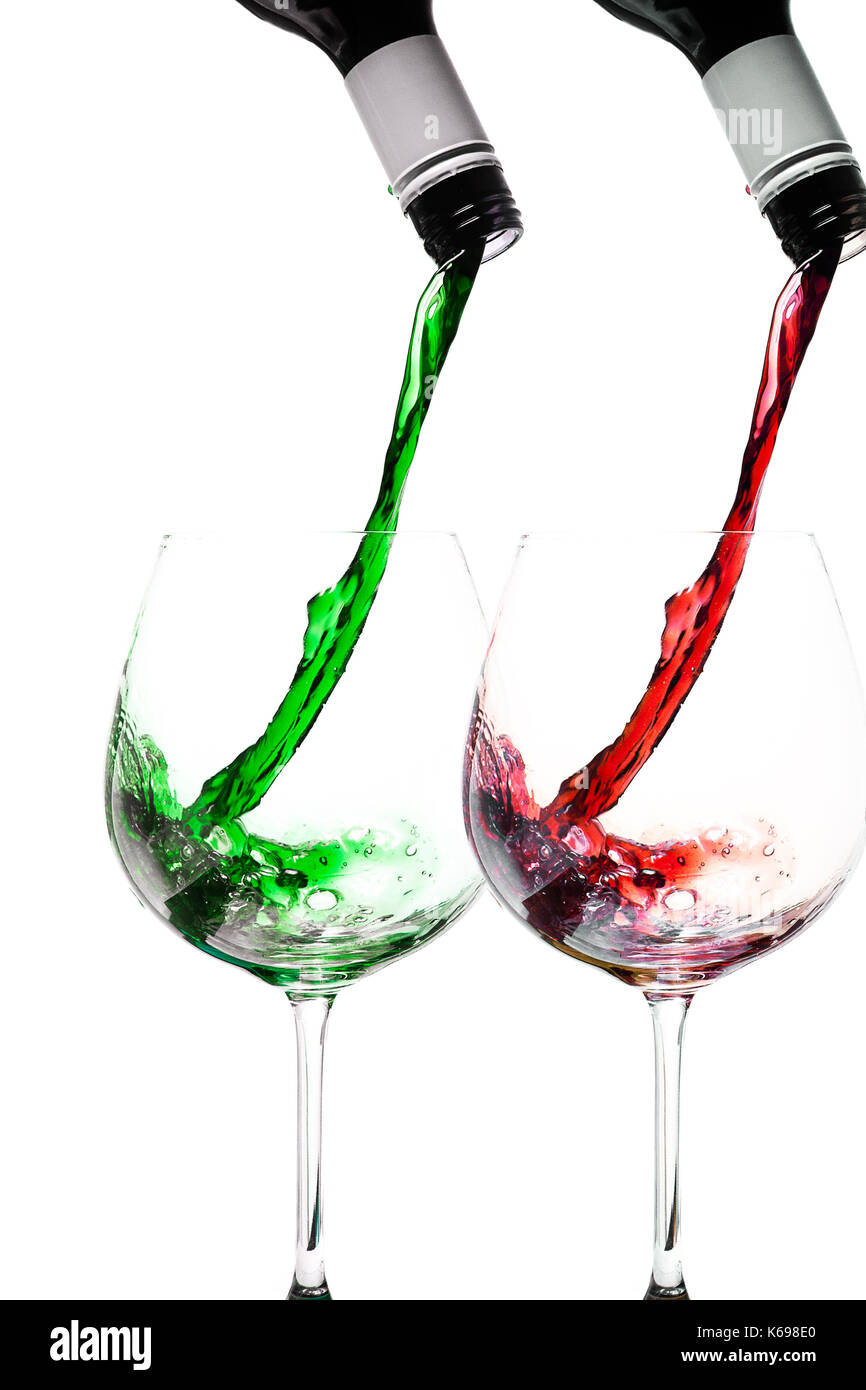wine pouring into wine glasses in xmas colours - Stock Image
