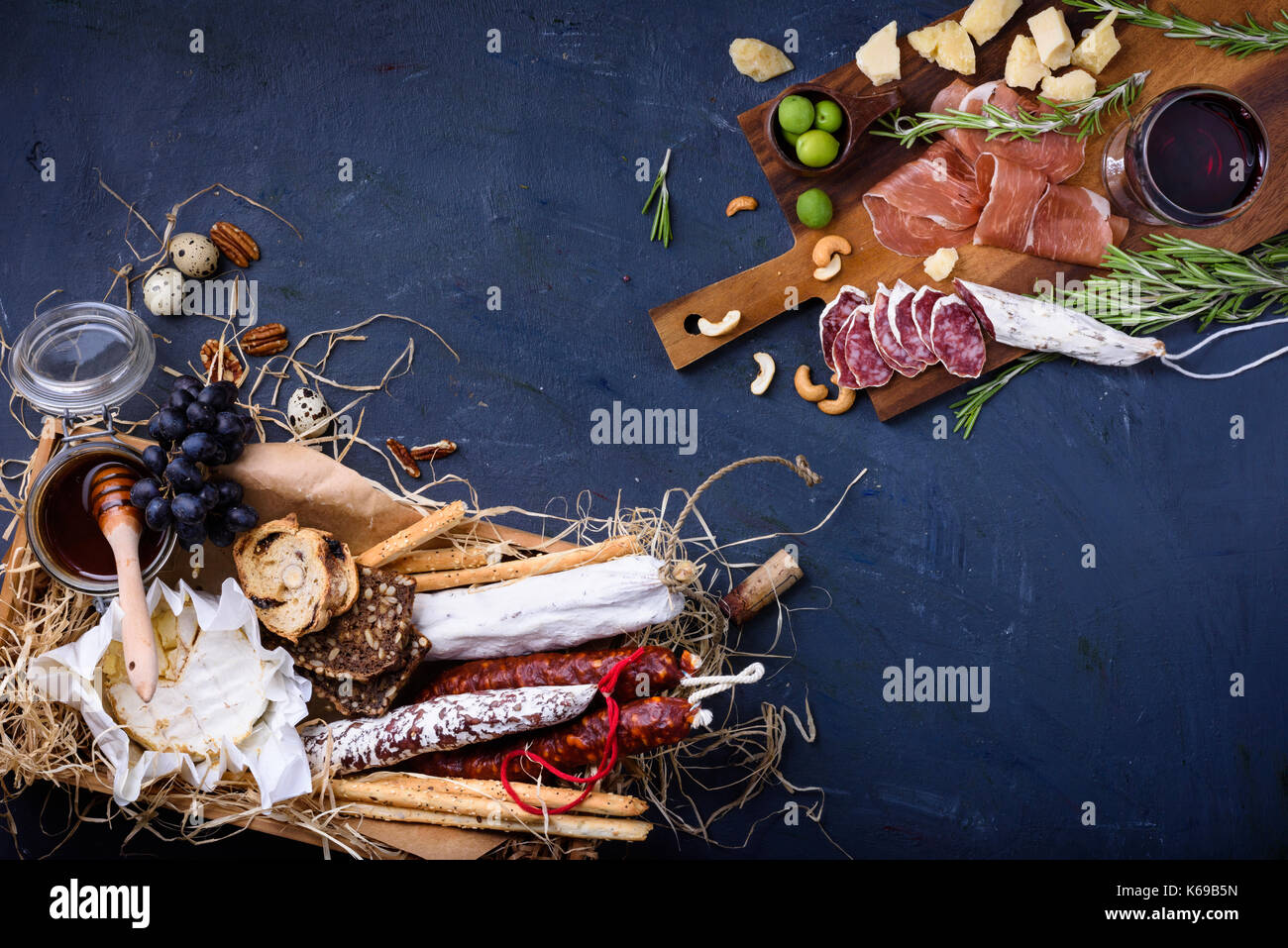 Antipasto appetizer with grape and olives. Assortment of meat and cheese snacks. Top view, copy space. - Stock Image