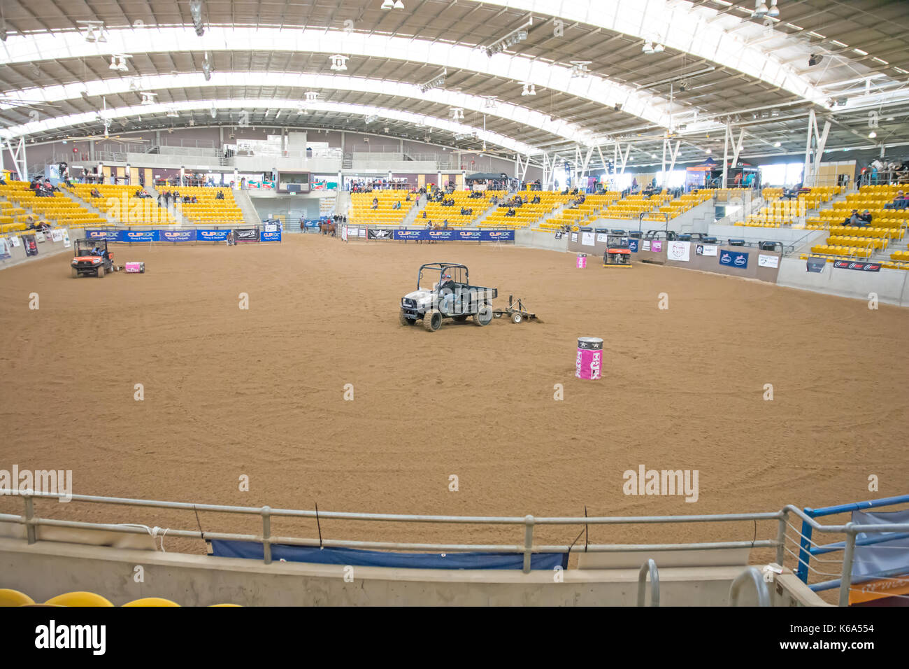 Golf Buggies raking and smoothing sand at he indoor arena at Australian Equine and Livestock Events Centre Tamworth Australia. - Stock Image