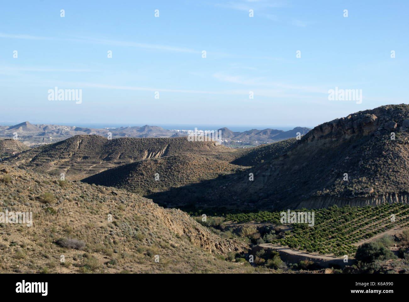 View of orange groves and across towards the sea from the Sierra Cabrera mountains, Almeria province, Spain - Stock Image