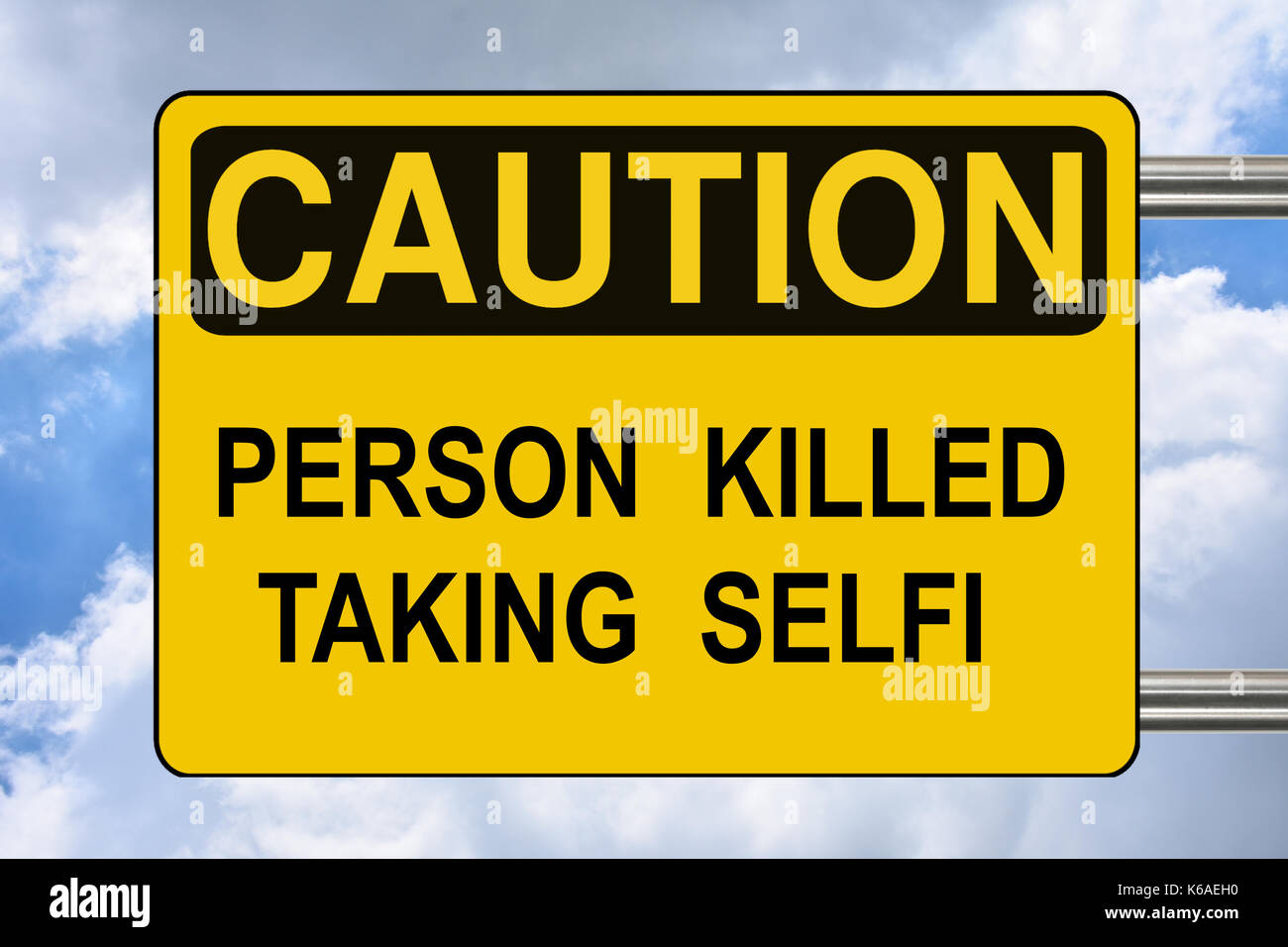 Person killed taking selfi, yellow road warning sign - Stock Image