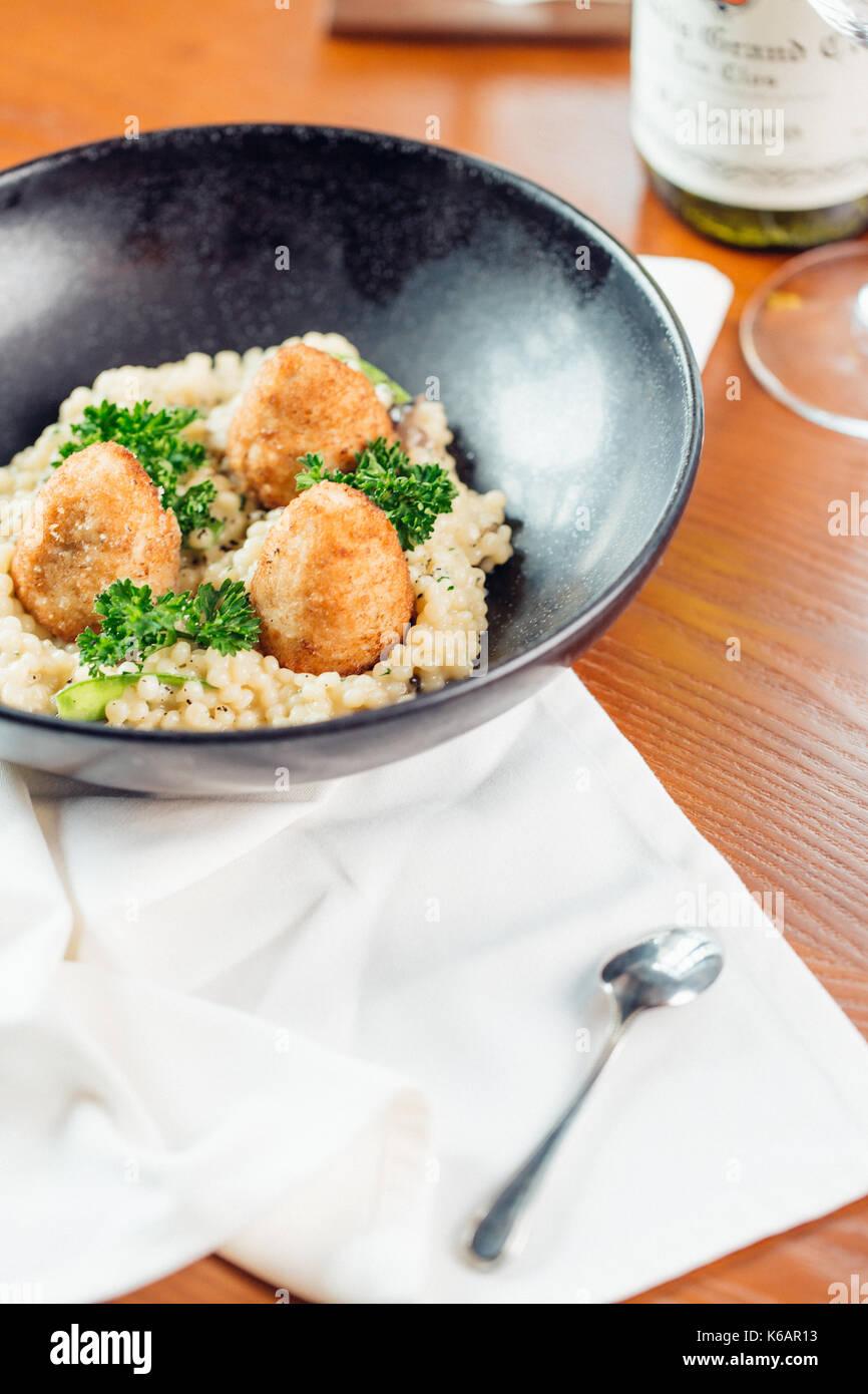 Bowl of oats porridge. Healthy breakfast on wooden table - Stock Image