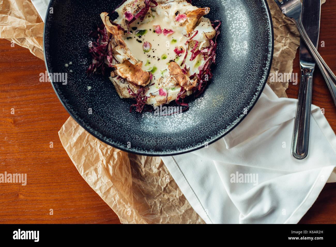 bowl of oatmeal porridge on wood background - Stock Image
