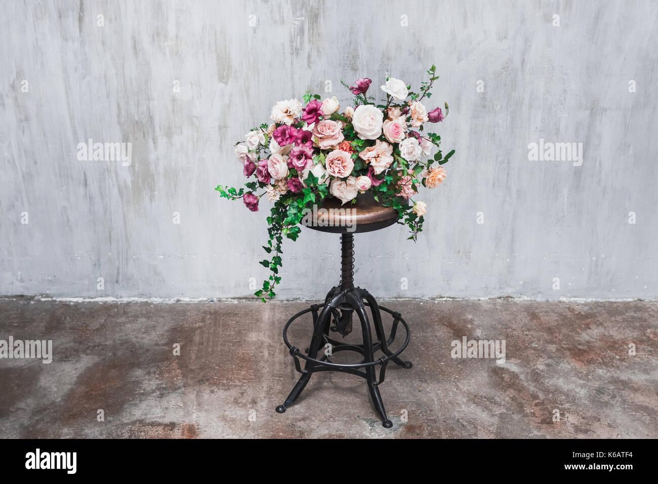 Wedding flower arrangement isolated on grey textured background ...