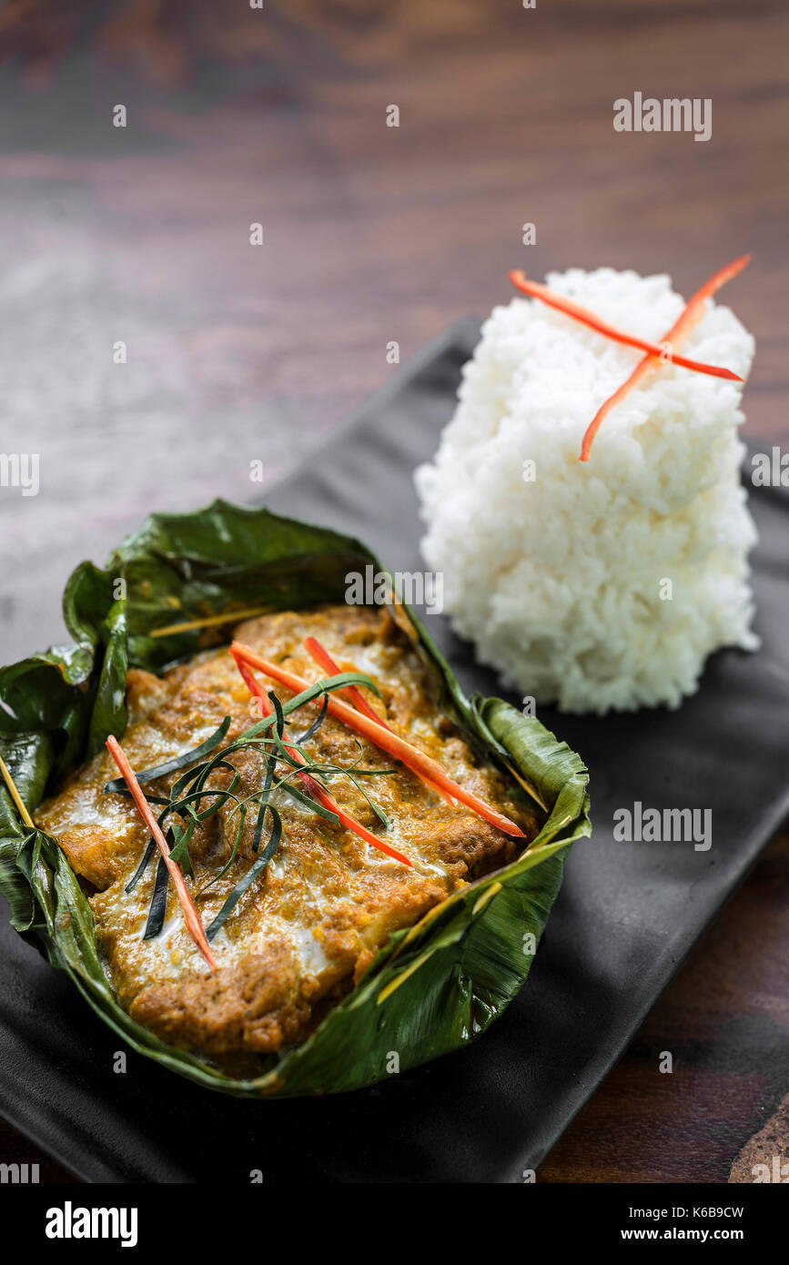 traditional Cambodian khmer  fish amok curry meal - Stock Image