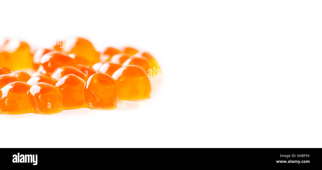 Red caviar salmon fish on white background. macro view shallow depth of field. Copy space - Stock Image