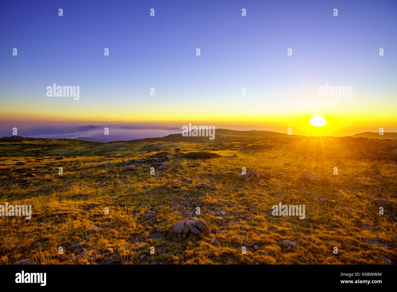 sunset on a summer day in the mountains - Stock Image