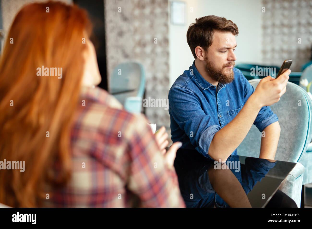 Jealous husband suspecting infidelity - Stock Image