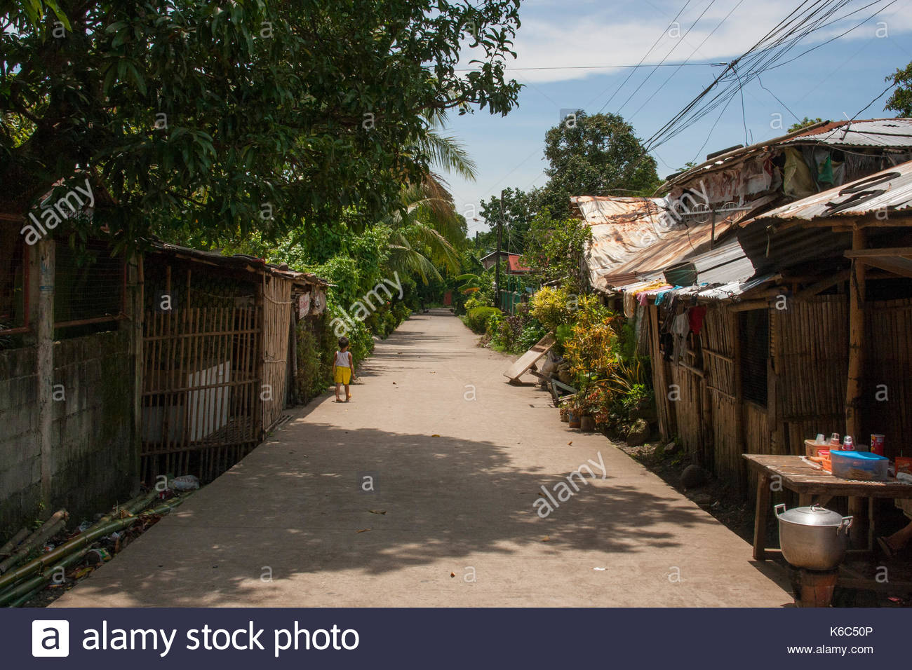 A countryside unpaved road in the suburbs of Bacolod - Stock Image