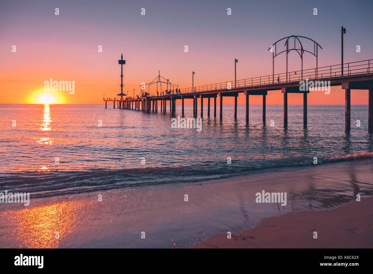 Brighton Beach pier with people at sunset, South Australia - Stock Image