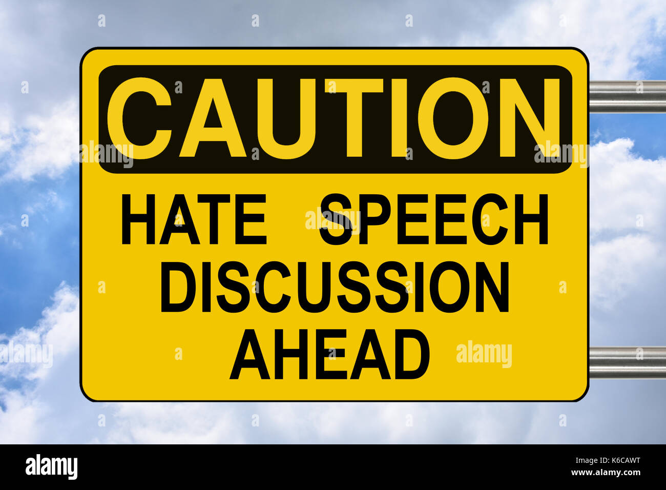 Hate speech ahead, yellow road warning sign - Stock Image