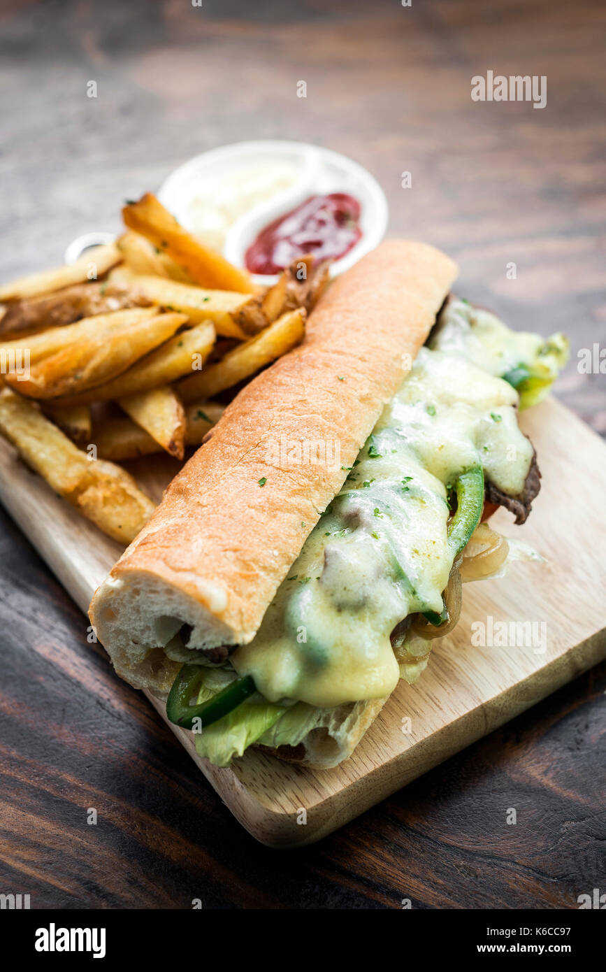 gourmet Philly Cheese steak american Sandwich with fries - Stock Image