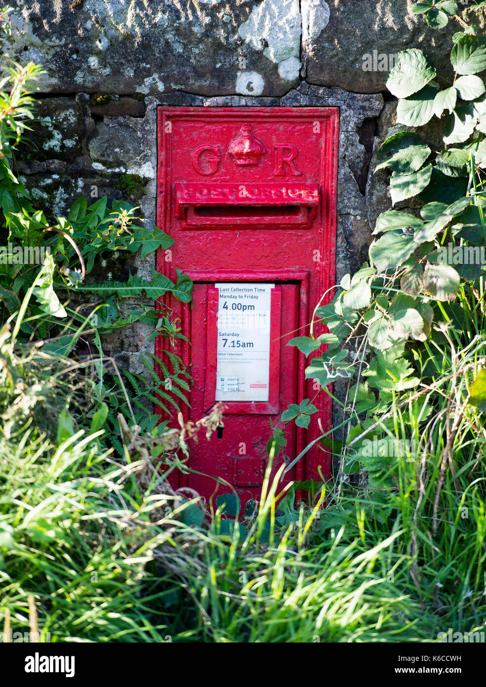 Wall Mounted Post Box with cypher GR for the reign of King George England, near Balfron Strirlingshire. - Stock Image