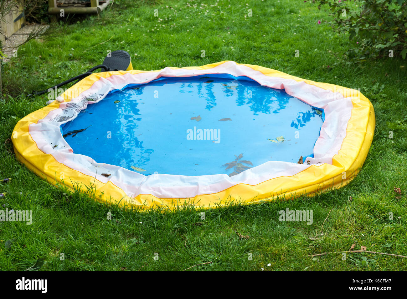 Little Swimming Pool Deflated At The End Of Summer   Stock Image