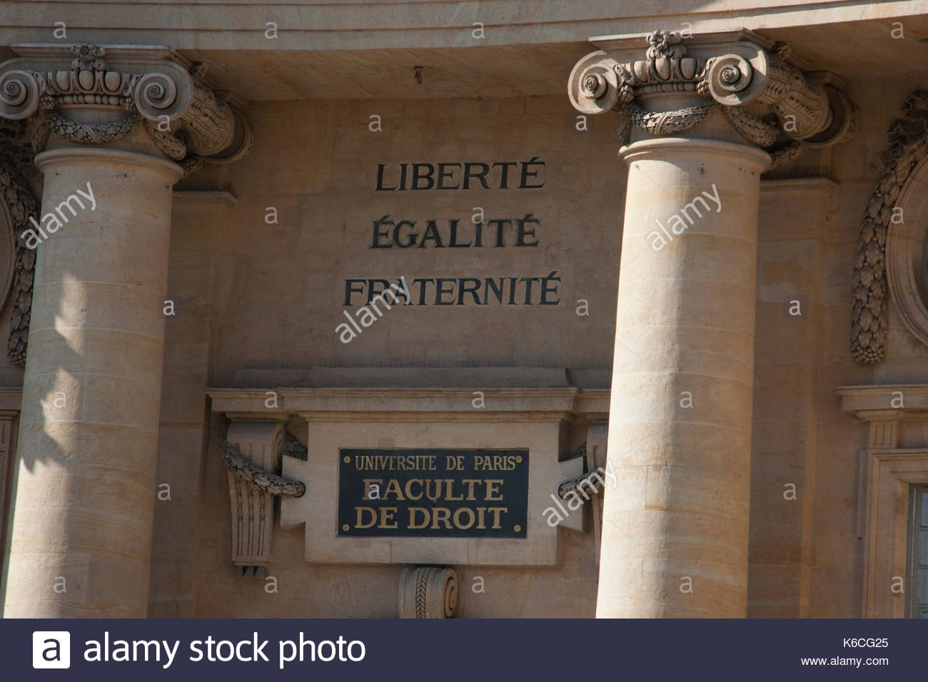 The famous French slogan  'Liberty, equality and fraternity' on the facade of the Law University building in Paris - Stock Image