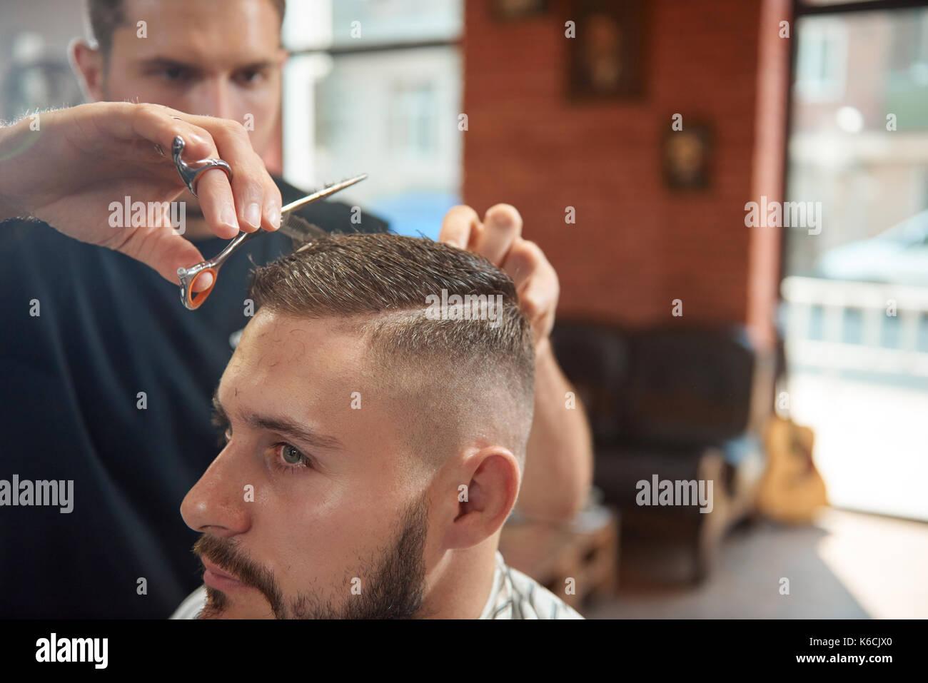 Young man at the barbershop - Stock Image