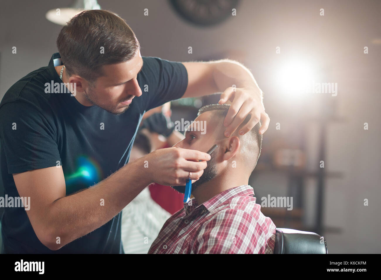 Young man at the barbershop - Stock Image