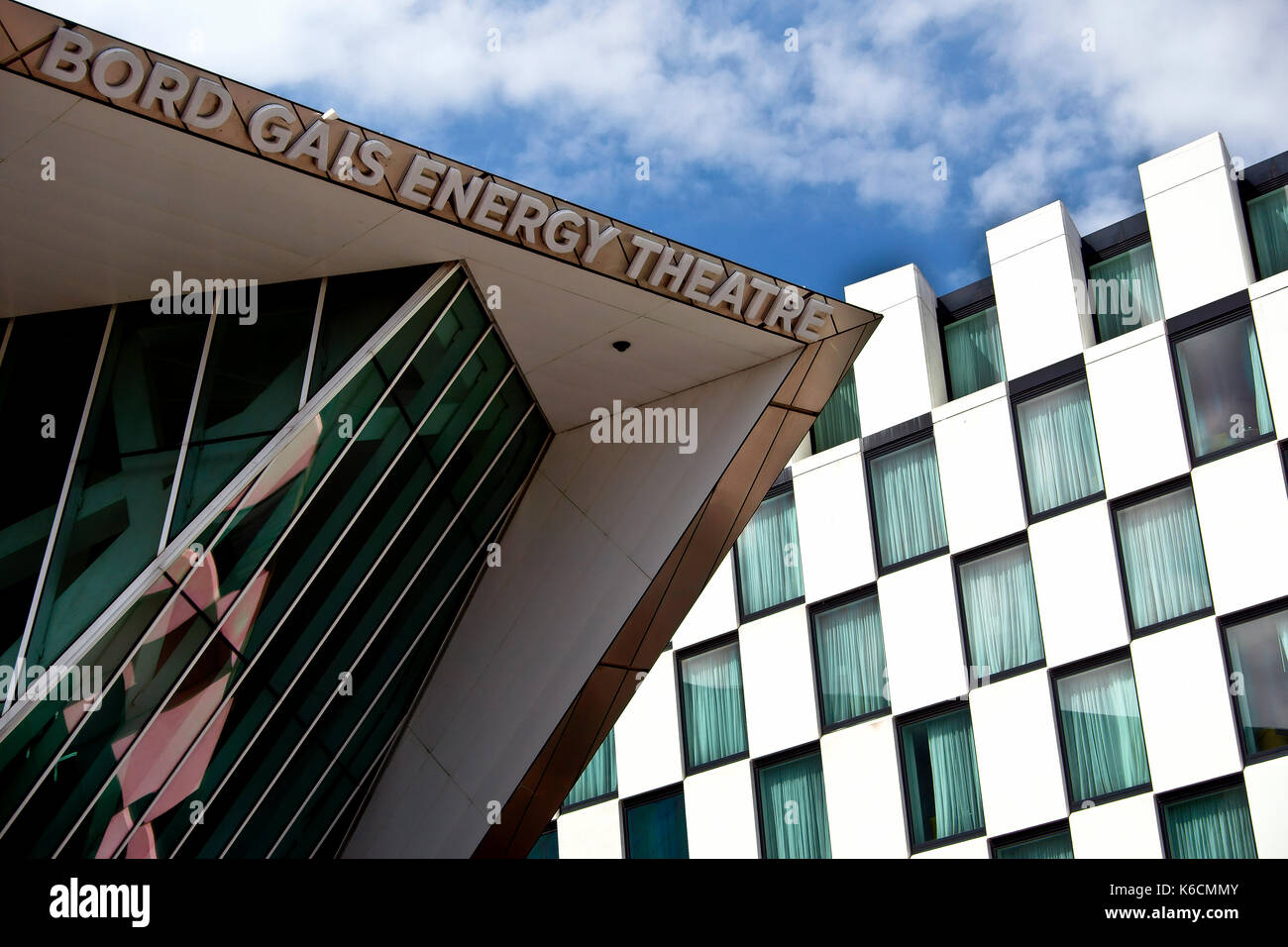 Bord Gais Energy Theatre by American architect Daniel Libeskind and facade of The Marker Hotel, Grand Canal Square, docklands. Dublin, Ireland, Europe - Stock Image