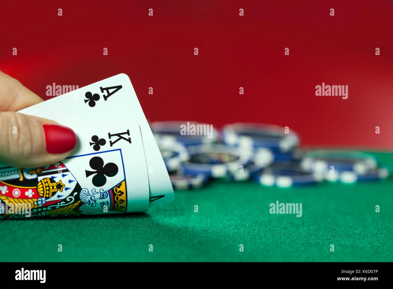 Women Hand Holds Ace with King and Poker Chips - Stock Image