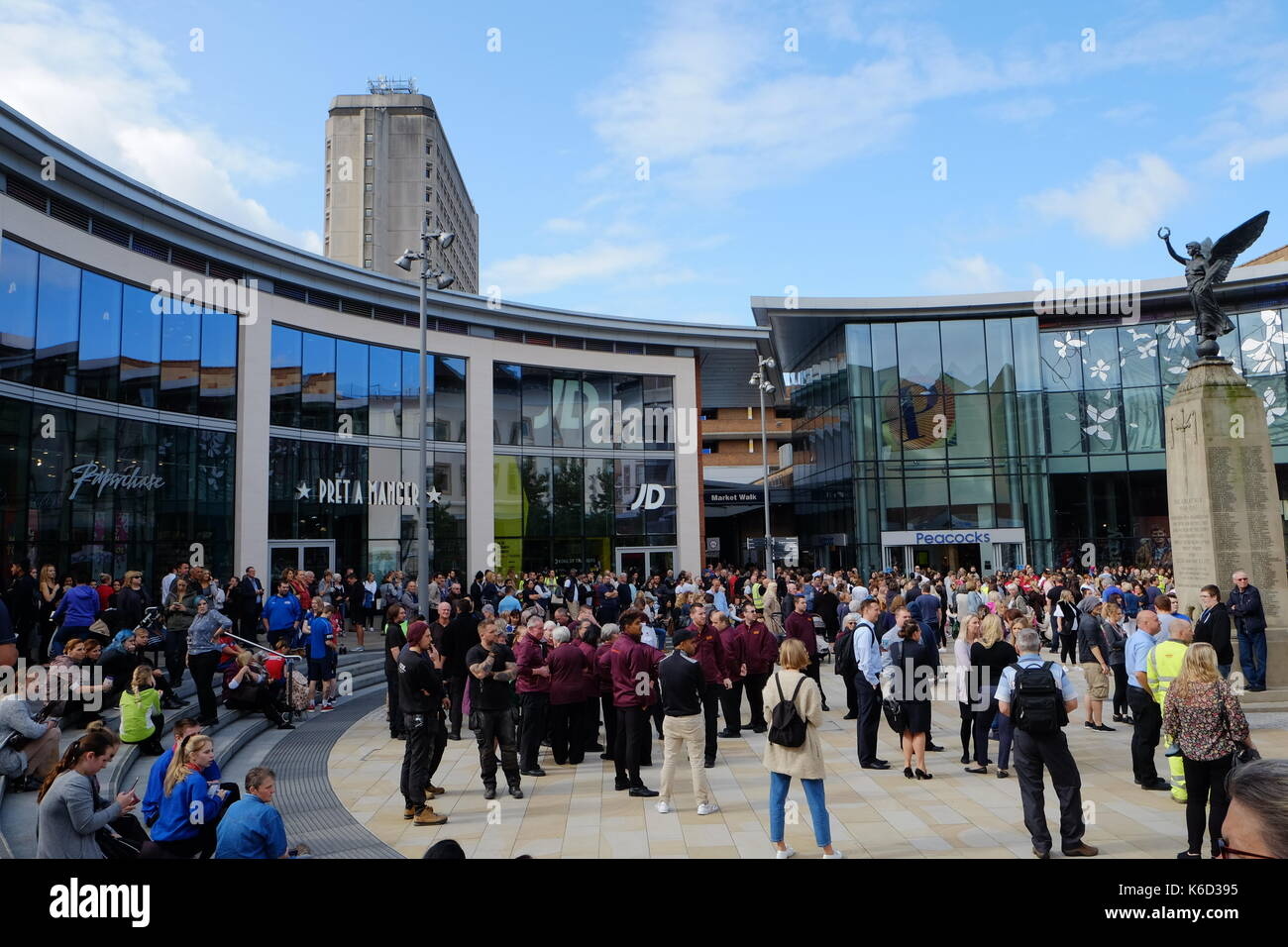 Woking, UK. 12th Sept. 2017. Shoppers gather in Jubilee Square after being evacuated from The Peacocks and Wolsey Place shopping centres, Woking. Credit: Jason Wood/Alamy Live News - Stock Image