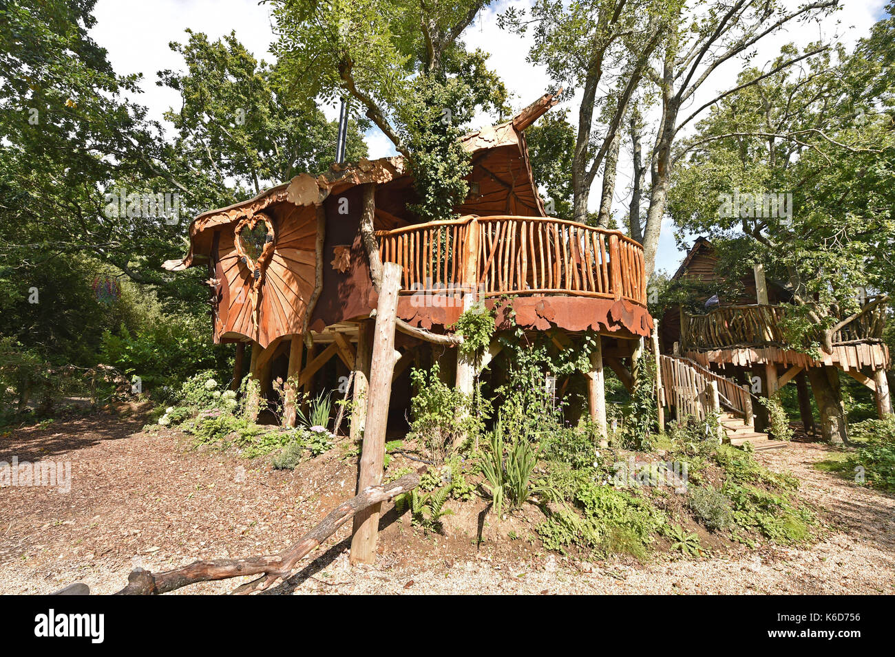 Ditchling Sussex, UK. 12th Sep, 2017. A new tree house has been unveiled at Blackberry Wood campsite near Ditchling in Sussex . The new upmarket tree house called Piggledy has been built by campsite owner Tim Johnson and is larger than the original next door tree house called Higgledy . The quirky campsite is well known for having a London bus and an old Wessex helicopter where people can also stay in peaceful surroundings nestled just north of the South Downs National Park Credit: Simon Dack/Alamy Live News - Stock Image