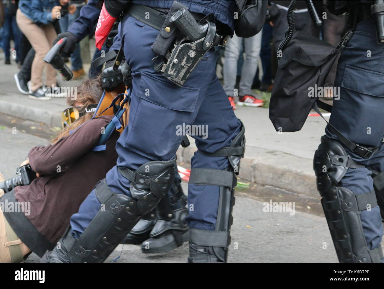 Paris, France. 12th Sep, 2017. A French snatch squad arrest protester after clashes following Loi Travail march in Paris Credit: Conall Kearney/Alamy Live News - Stock Image