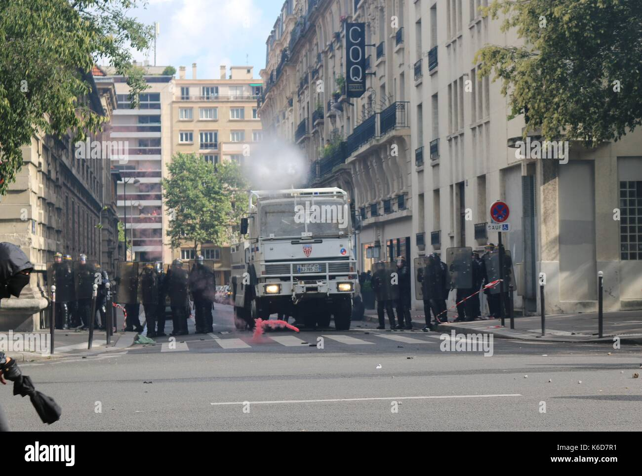Paris, France. 12th Sep, 2017. Water cannon is deployed after clashes in Paris Credit: Conall Kearney/Alamy Live News - Stock Image