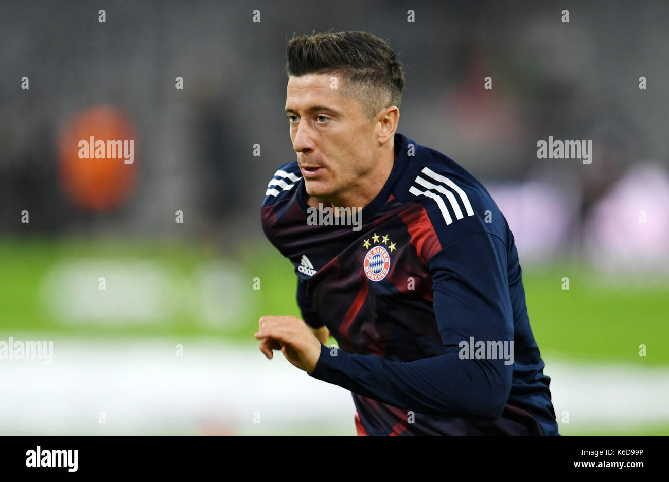 Munich's Robert Lewandowski warms up before the Champions League Group B match between Bayern Munich's and RSC Anderlecht at the Allianz Arena in Munich, Germany, 12 September 2017. Photo: Tobias Hase/dpa - Stock Image