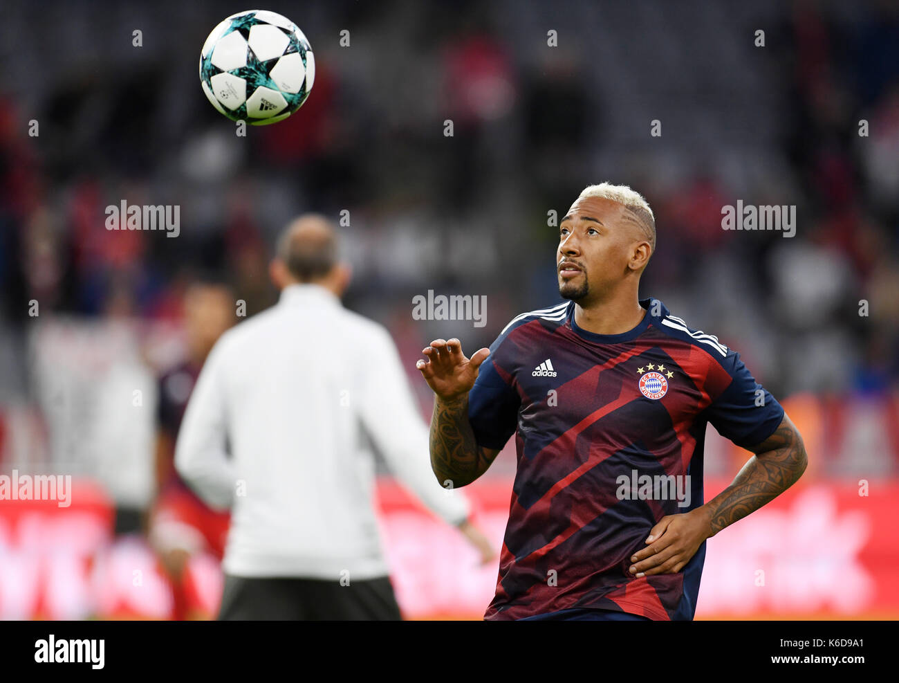 Munich's Jerome Boateng warms up before the Champions League Group B match between Bayern Munich's and RSC Anderlecht at the Allianz Arena in Munich, Germany, 12 September 2017. Photo: Andreas Gebert/dpa - Stock Image