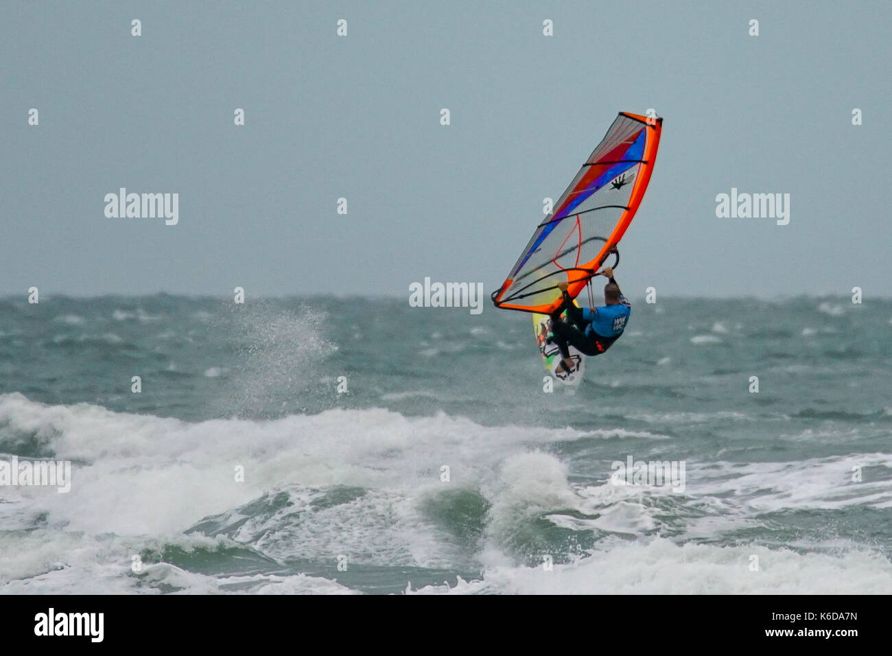 West Strand, West Wittering. 12th September 2017. UK Weather. Low pressure conditions brought high winds to the south coast today as Storm Aileen approached the UK. Windsurfers enjoying the conditions at West Wittering beach in West Sussex. Credit: james jagger/Alamy Live News - Stock Image