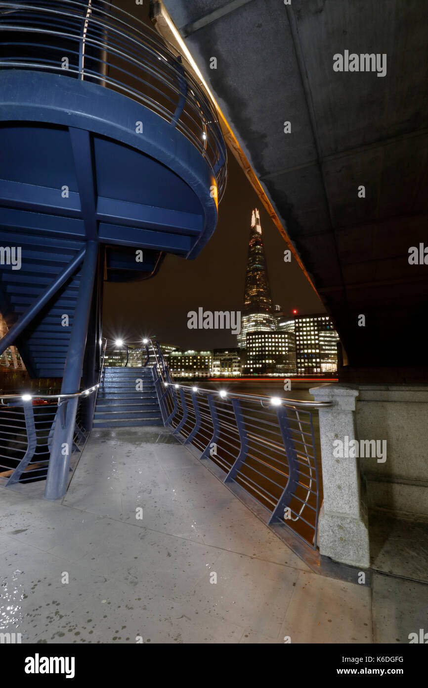 London, The Shard viewed from the pedestrian stairway to new London Bridge on the Thames North bank at night - Stock Image