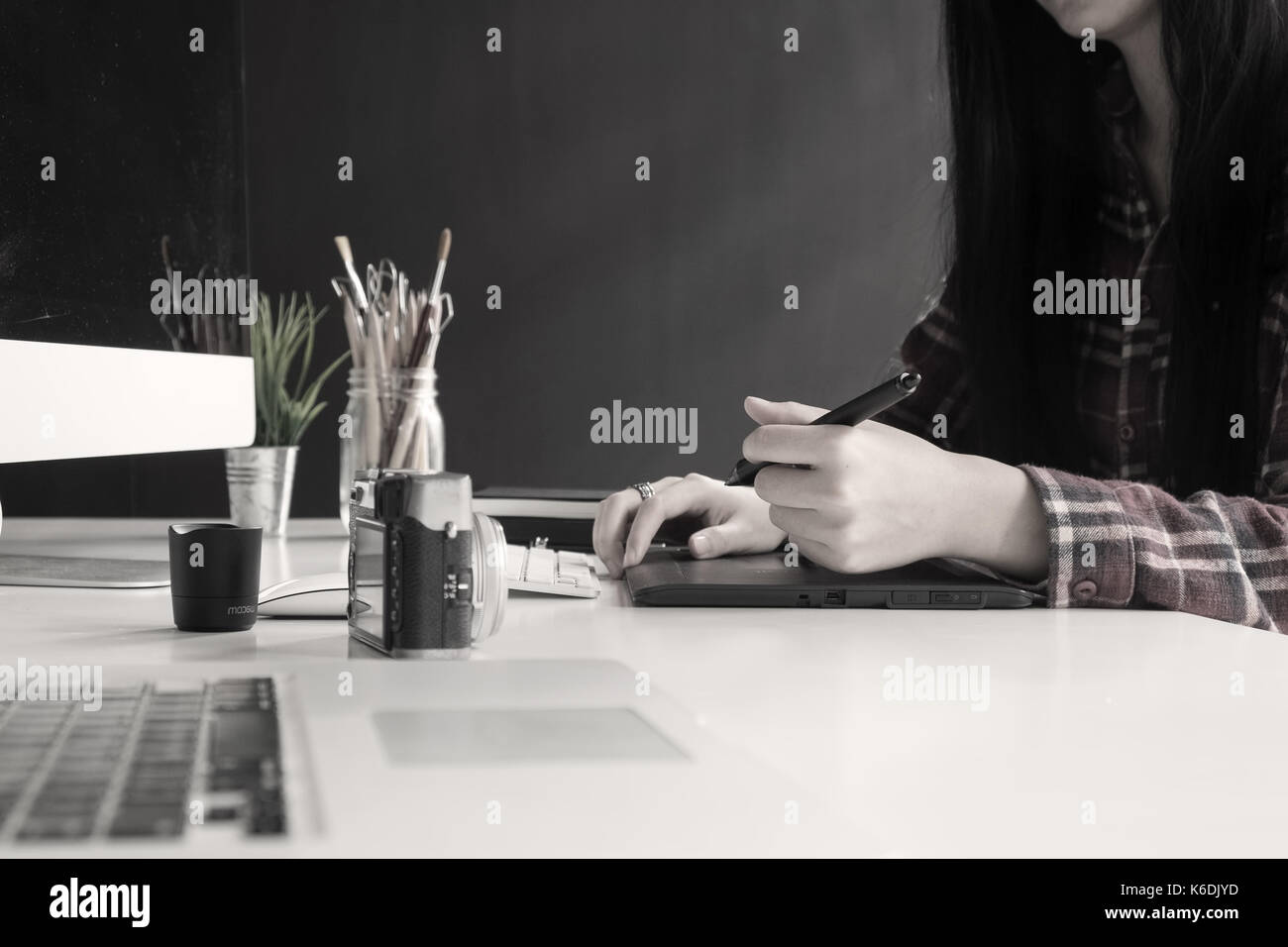 woman artist drawing something on at the creative office, graphic design concept. - Stock Image