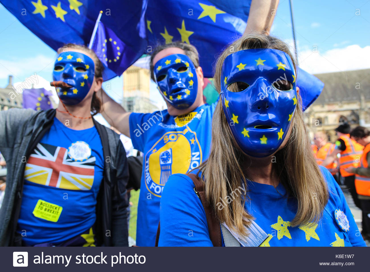 Three masked protesters at a rally in Central London against the Brexit process. - Stock Image