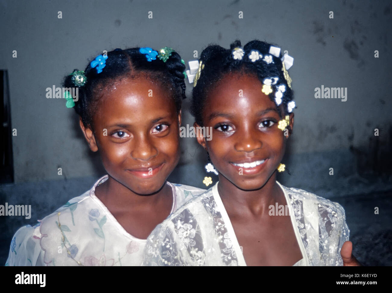 Portrait of two smiling jamaican girls - Stock Image