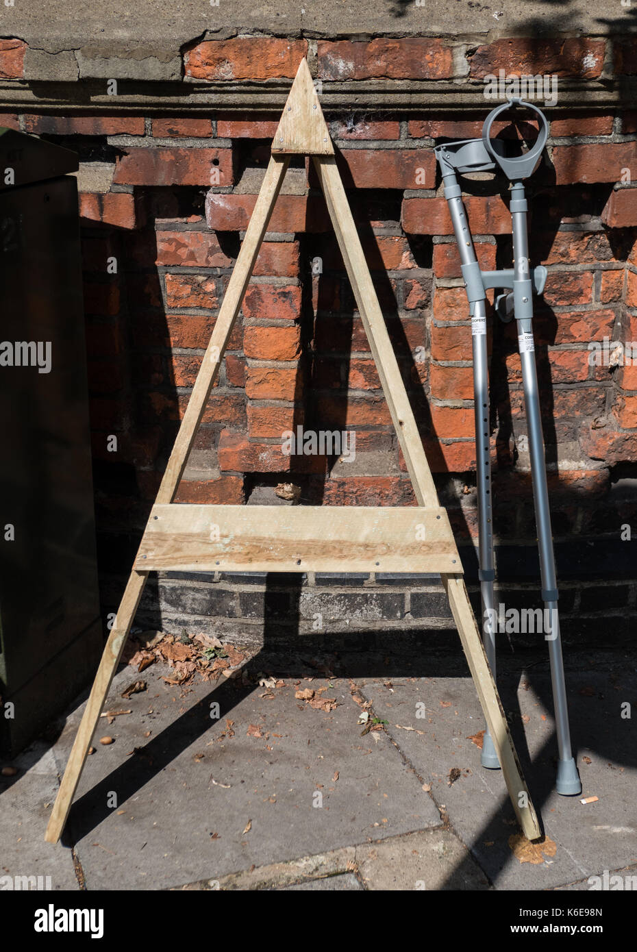 A wooden template and two abandoned crutches - Stock Image