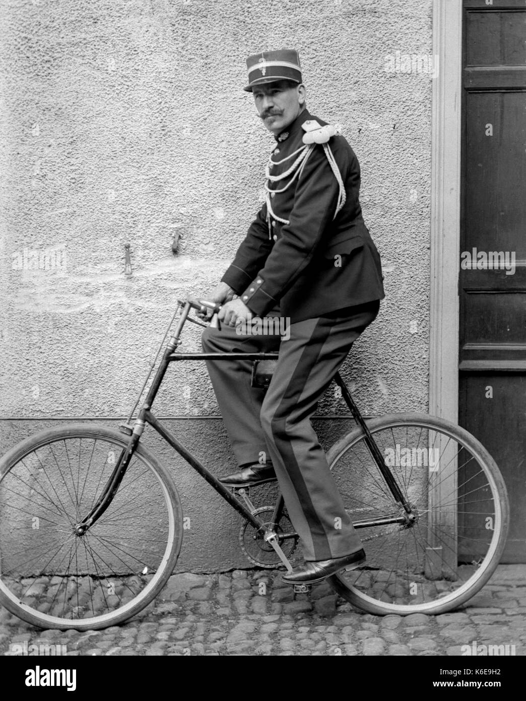 AJAXNETPHOTO. 1891-1910 (APPROX). SAINT-LO REGION, NORMANDY.FRANCE. - MAN ON A BICYCLE DRESSED IN FRENCH ARMY UNIFORM DATING FROM THE 1870S FRANCO-PRUSSIAN WAR.
