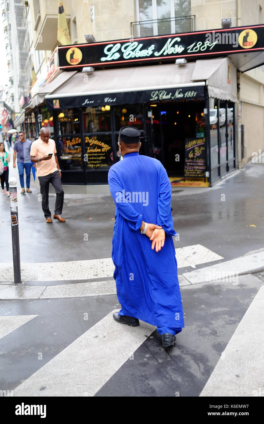 A Moslim man walks through the streets of La Pigalle, the red light district of Paris - Stock Image