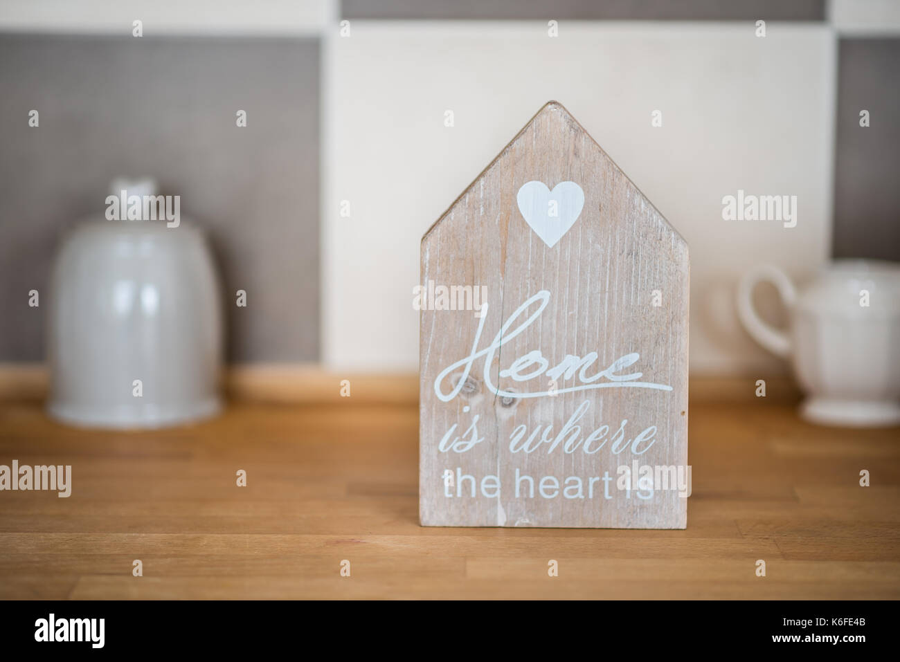 Home sweet home sign on kitchen counter - Stock Image