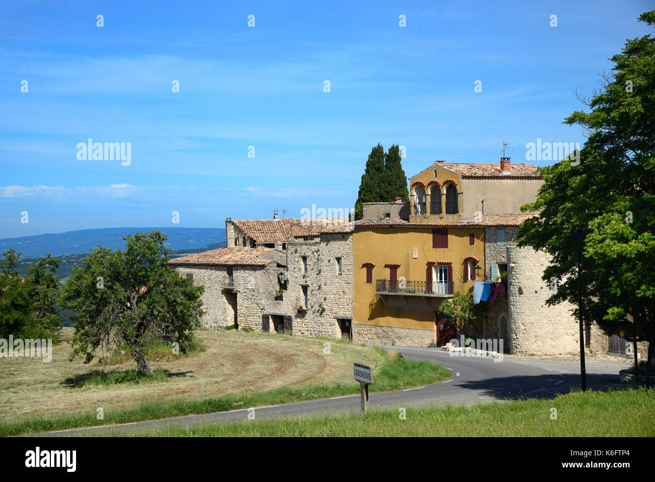 View of the Perched Village or Hilltop Village of Caseneuve in the Luberon Regional Park Vaucluse Provence France - Stock Image