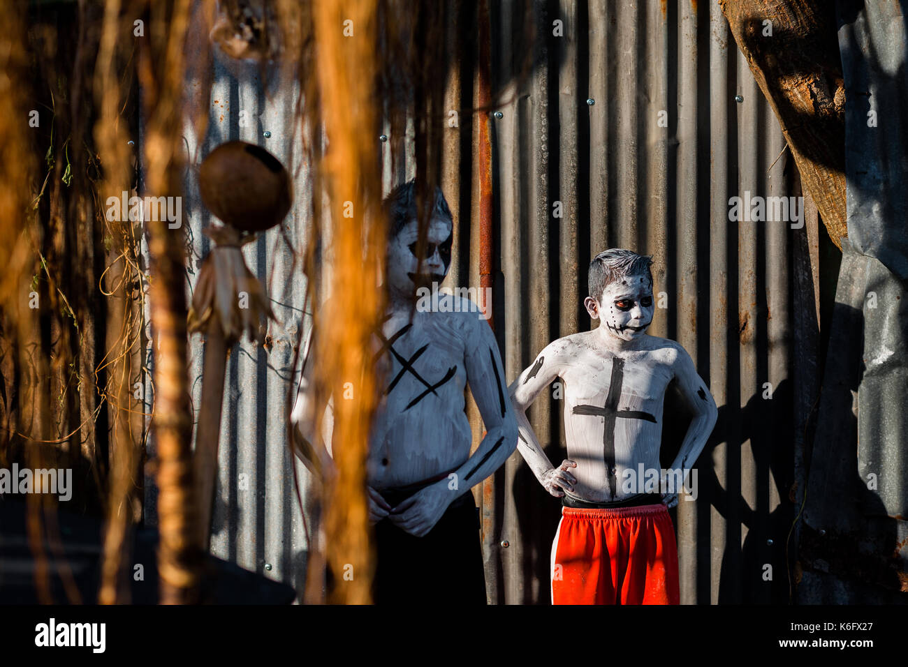 Salvadoran boys, having white body paint with death symbols, perform during the La Calabiuza parade at the Day of the Dead festivity in Tonacatepeque, - Stock Image